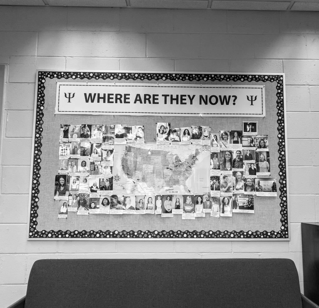 Alumni photos and map on bulletin board